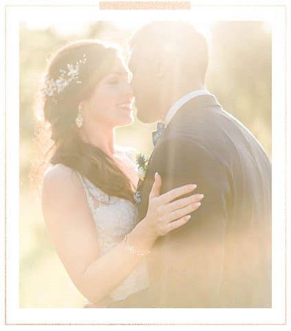 Recent weddings header image - bride and groom kissing in the sun